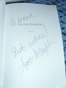 """autographed copy of """"In Her Shadow"""" by August McLaughlin"""